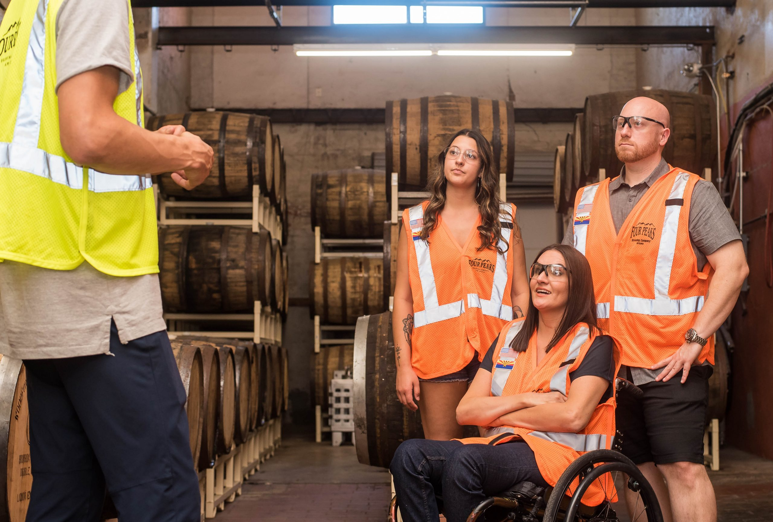 employee in wheelchair with co workers
